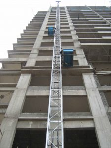 High rise tower material shifting-compressed